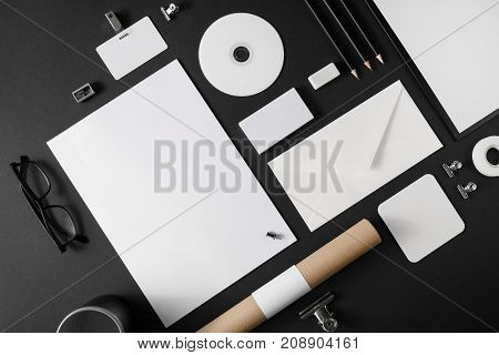 Blank simple stationery mock-up on black paper background. Branding template.