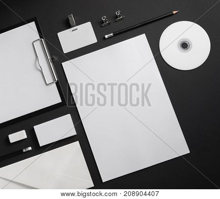 Corporate identity template. Blank business stationery set on black paper background.