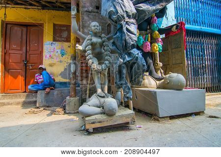 KUMARTULI KOLKATA INDIA - OCTOBER 10 2014 : Clay idol of Goddess Kali at Kumartuli Kolkata India. Idols are being prepared to be worshipped during Kali Puja Hindu festival of Deepavali or Diwali.