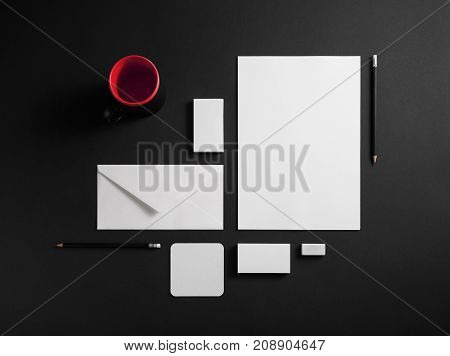 Mockup business template. Photo of blank corporate stationery set on black paper background.
