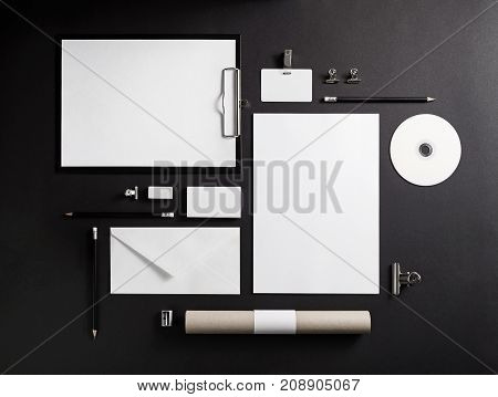 Blank branding template. Corporate stationery on black paper background. Top view.