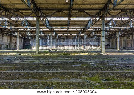 Abandoned large factory industrial interior. Inside the ruins of an old factory in Romania of a Communist Era. Step inside of abandoned old factory in eastern Europe.
