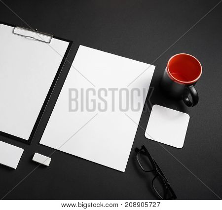 Photo of blank stationery set on black background. Business brand template.