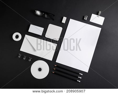 Corporate identity template on black paper background. Photo of blank stationery. Mock up for design portfolios.