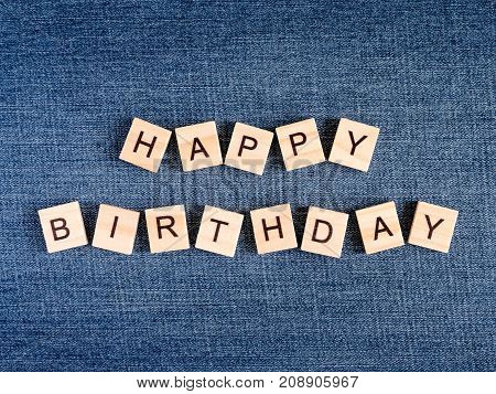 Word spell Happy Birthday on Jean fabric background