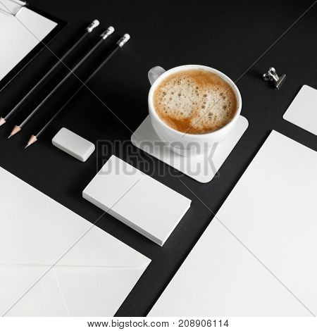 Photo of blank corporate stationery set on black paper background. Brand identity template.