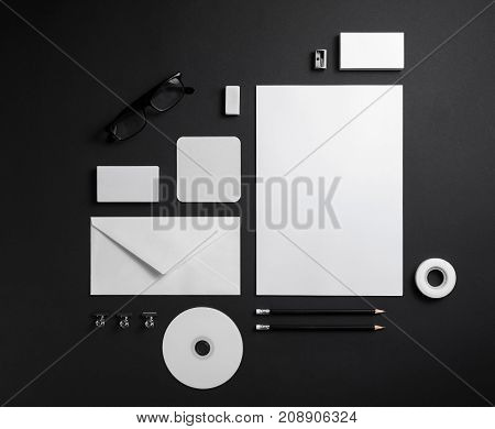 Blank corporate stationery on black paper background. Branding mock up. Template for graphic designers portfolios.