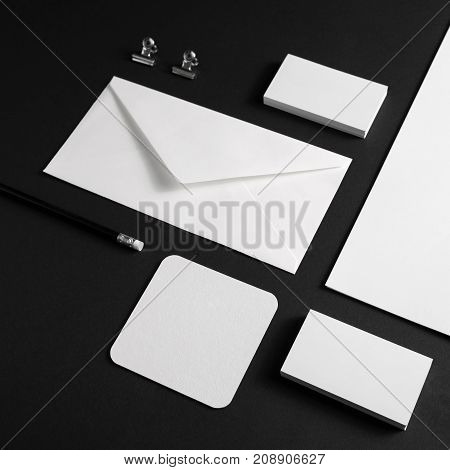 Branding identity mock up. Blank corporate stationery template on black paper background.