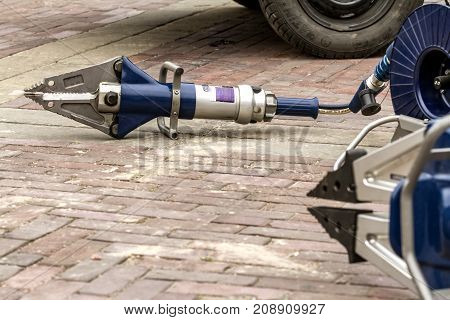 ZAMOSC/POLAND -AUGUST 13,2017: Hydraulic power rescue tool for cuuting cars after accidents.