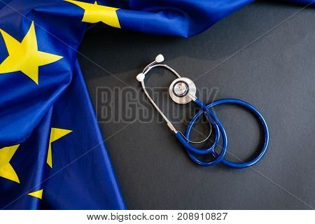Cost of health care concept stethoscope and calculator on document and eu flag