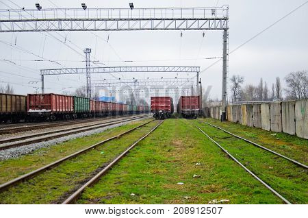 View On Railroad Tracks And Cargo Train