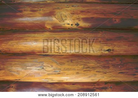 Background of horizontal hewed smooth wooden logs. modern log house indoor.