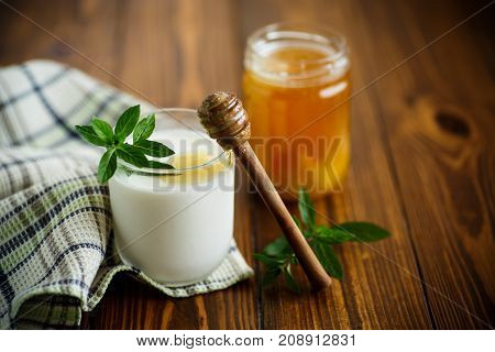 sweet homemade yogurt with honey on a wooden table