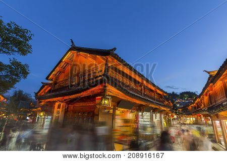 Lijiang old town in the evening with crowd tourist.