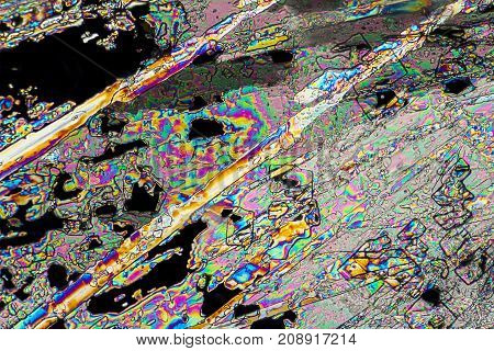 colorful microscopic shot of liquid fertilize microcrystals in polarized light