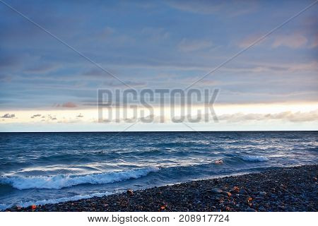 Beautiful evening view of the sea under a cloudy sky