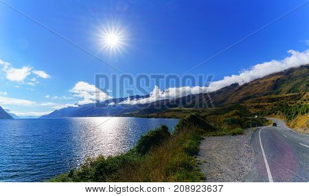 Panoramic image of beautiful backlit of Lake Wakatipu South Island of New Zealand