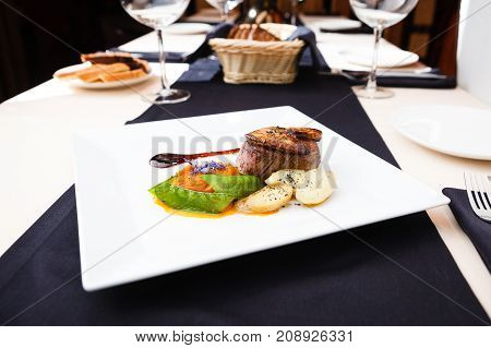 Beef fillet with potato gratin and fresh salad