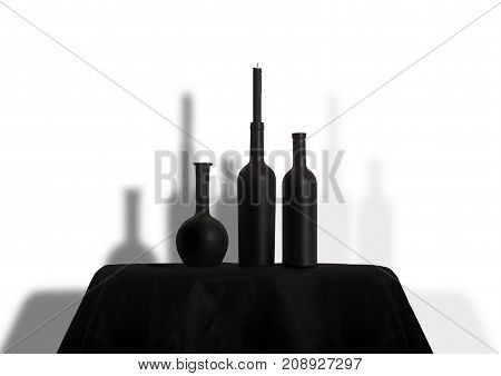 dark black bottles and candles on a black tablecloth. Halloween party