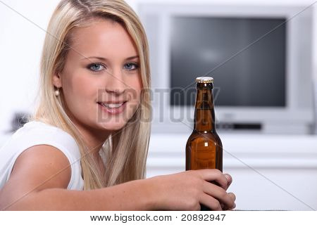 blonde bombshell with bottle of beer
