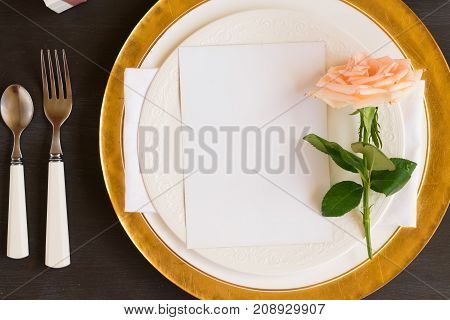 Tableware - set of plates and utencils with rose flower and copy sapce on empty white card