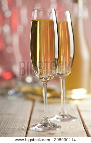 Two Glasses Of Champagne On Red Background