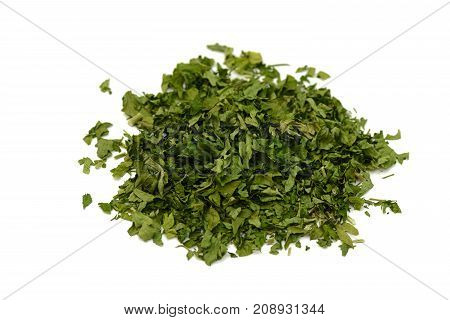 pile of green dried parsley on a white background