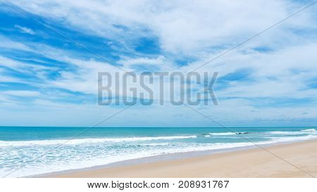 tropical andaman seascape scenic off patong beach phuket thailand with wave crashing on sandy shore