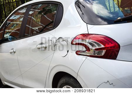 A car with a scratch on the body. Close-up