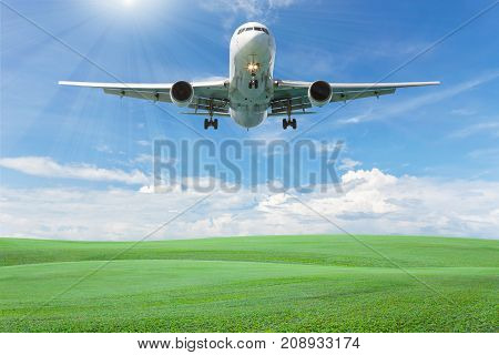 Blank billboard for your advertisement with space for text on green grass fieldblue sky white cloud background
