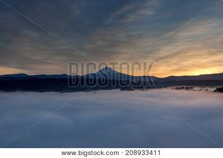 Rolling fog low clouds over Sandy River Valley and Mount Hood during sunrise