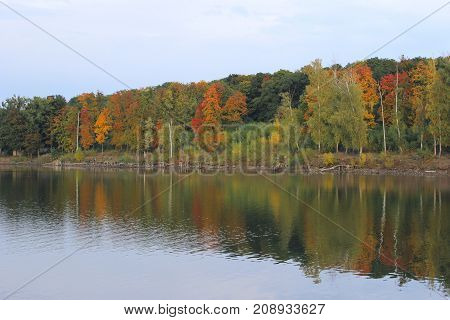 Autumn Landscape. Park in October. The Bright Colors of Autumn In The Park By The Lake. Beautiful Lake View In Autumn.Autumn Colors on The Lake.