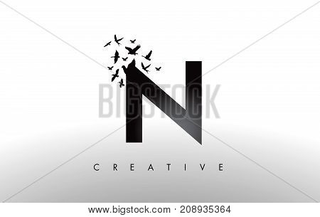 N Logo Letter With Flock Of Birds Flying And Disintegrating From The Letter.