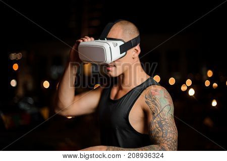 stylish man with virtual reality glasses looking amazed. Selective focus.