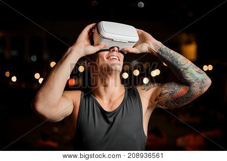 Portrait of man and vr glasses playing an exciting game. Concept of the future is here. Toned image.