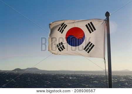 South Korea flag waving against clean blue sky close up isolated with clipping path mask alpha channel transparency