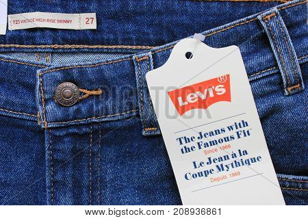 MOSCOW, RUSSIA - OCTOBER 8, 2017: Levi's Denim Jeans with Labels and Company Logo Background. Levi Strauss is an U.S. clothing company selling clothes and famous for classic jeans.