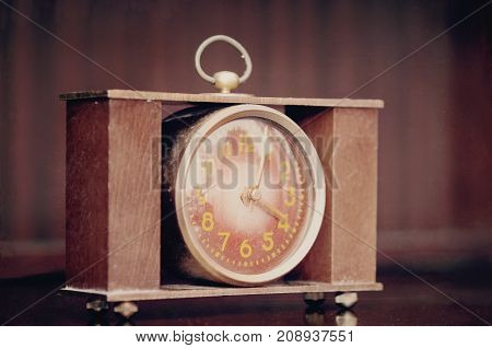 old mechanical clock with arrows for four