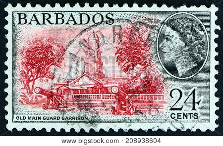 BARBADOS - CIRCA 1953: A stamp printed in Barbados shows Old Main Guard Garrison and Queen Elizabeth II, circa 1953.