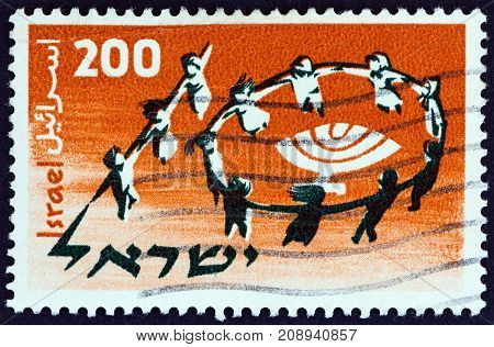 ISRAEL - CIRCA 1958: A stamp printed in Israel issued for the 1st World Conference of Jewish Youth, Jerusalem shows dancing children forming number 10, circa 1958.