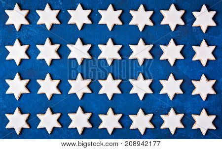 Cinnamon Star Cookies Christmas pattern on a blue background.