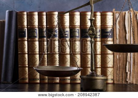 Law and justice concept - antique scales with row of law books