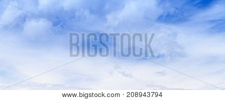 White Clouds In Blue Sky At Summer Day