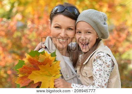 Portrait of mother and daughter having fun  outdoors