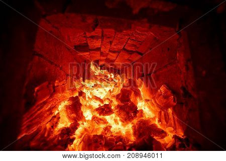The wood burning in the fire of the russian furnace. Inside view.