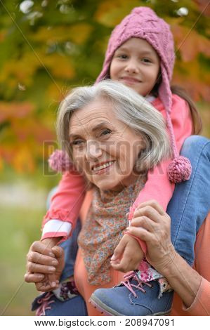 Portrait of grandmother and granddaughter in park