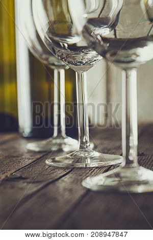 Wine. Empty wine glass. in wine cellar. Old white wine on wood.Arranged wine glasses