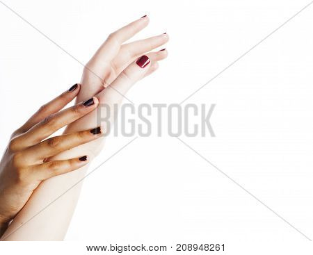 two different nathion manicured hands on white isolated, african with caucasian