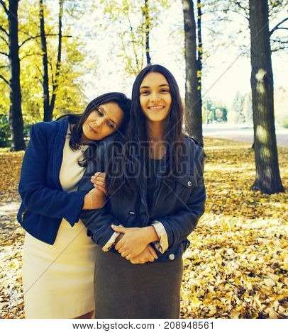 mature real mother with daughter outside autumn fall