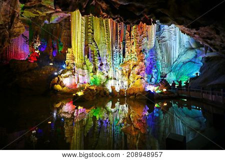 Colour Light Illuminated Cave Landscape, with mirror reflection. Silver Cave, Guilin, China